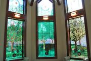 The Kobacker House chapel features stained glass depicting a pear tree's life cycle through the seasons.