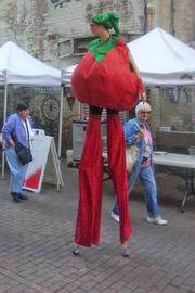 A person dressed as a tomato on stilts was wandering around the Pearl Market on Tuesday. The market is open from 10:30 a.m. to 2 p.m. on Tuesdays and Fridays until October.