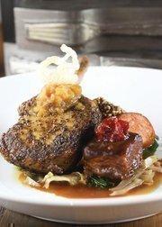 The Pork Trio has a mustard-rubbed pork chop, smoked kielbasa and braised pork belly.