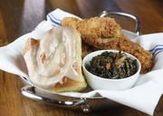 Entrees include Southern Fried Chicken, with a cinnamon sticky bun and cider-braised green.