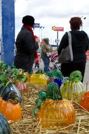 Crafts like these glass pumpkins are for sale at the show.