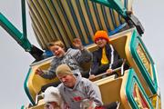 This young thrill seeker kept his pumpkin haton while enjoying the rides.