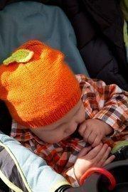 Visitors of all ages adorn pumpkin hats.