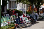 People hold their spots for the four-day event, which has seven parades throughout.