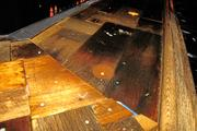 The bar top was cobbled together with random pieces of wood, glass, pieces of barn, and other detritus.