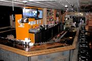 At the center of the 2,700-square-foot space is a J-shaped bar.