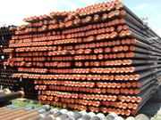 Steel pipes ready for shipping to drilling sites are stacked across Ken Miller Supply's pipe yard.