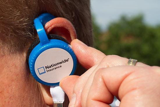 Earpieces that transmit Sirius XM Radio broadcast on the Memorial Tournament are being given away by top sponsor Nationwide.