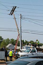 A utility pole at Route 256 and Tussing Road just south of I-70 was barely standing after the storm.