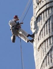 They also use regular cameras to take close-up photographs. In this shot, Mike Gilbert is documenting his work on the northeast side of the tower.