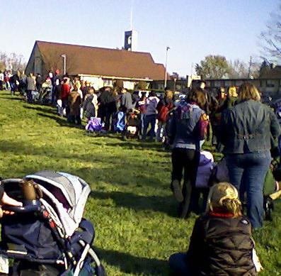 Long lines at publicly run vaccination clinics were a common sight in fall 2009 as the first limited supplies of H1N1 vaccine became available to restricted populations. The Ghose family stroller can be seen in the foreground of this line at a Gahanna church.