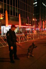 Ohio State Highway Patrol Trooper David Bever and his bomb-sniffing K-9 Tosi helped provide security.