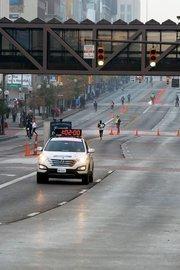 An hour and two minutes after the start, Half Marathon winner Julius Koskei of Kenya made his way up High Street toward an eventual finish of 1:03:44.