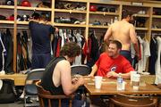 Players' pre-game rituals vary during their down time in the clubhouse before taking the field.