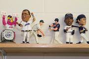 Souvenirs from past bobblehead giveaways adorn a shelf in the Clippers' clubhouse.