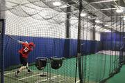 As game time approaches, players can take some swings in Huntington Park's indoor batting cage.