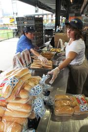 Meanwhile, elsewhere in the stadium, concession workers prepare for what's expected to be a busy evening with a playoff crowd and Dime-A-Dog night.