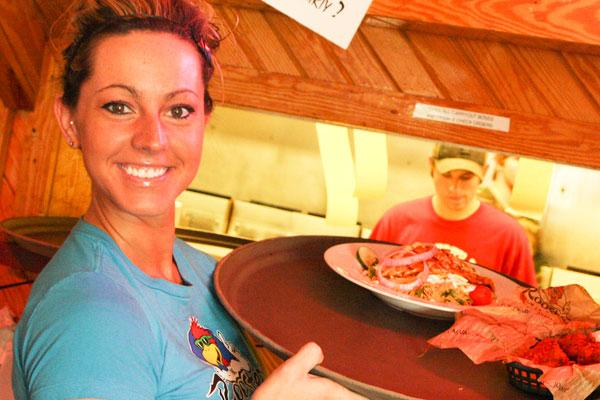 Roosters has kept Amanda Borojevich and her fellow servers busy with a low-cost strategy that has helped the chain expand despite the sluggish economy.