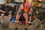 Stanton, an amateur strongman competitor, is cheered on as he attempts to beat his personal lift best of 665 pounds.