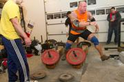 Preparing for the medley, Stanton displays his agility as he moves from the weighted yokes to lift a weighted keg.
