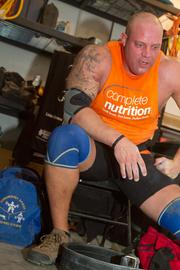 Stanton rests during a Saturday workout, which puts immense strain on his body.