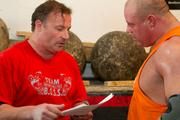Stanton's coach, Rick Freitag, owner of the Team B.O.S.S. center in Plain City, controls the strongman competitor's training.