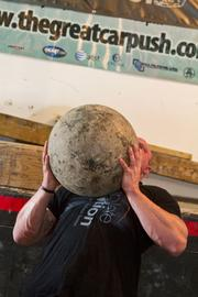 Stanton sets a stone as he prepares to lift it over his head.