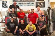 """Stanton and his Team B.O.S.S. """"brothers"""" who regularly train for strongman competitions."""