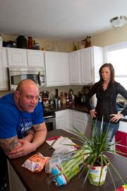 Stanton at home with his wife, Brandy, who takes care of his diet and watches over her husband. Stanton encounters blurred vision after heavy lifts during the Saturday workouts.