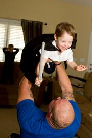 An easy lift -- Stanton plays with his 2-year-old son Liam at home.