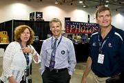 Greater Columbus Sports Commission chief Linda Logan, left, shows off all the activity to the Columbus Foundation's Doug Kridler, middle, and Tom Pingel, senior director of USA Volleyball.The tournament is the largest event brought to Columbus by the commission, which is celebrating its 10-year anniversary.