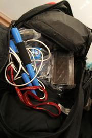 Boggs' backpack includes jump ropes, hair bands, water and chocolate for energy.
