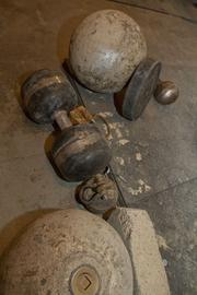 Tools of the strongman trade -- stones and massive barbells.