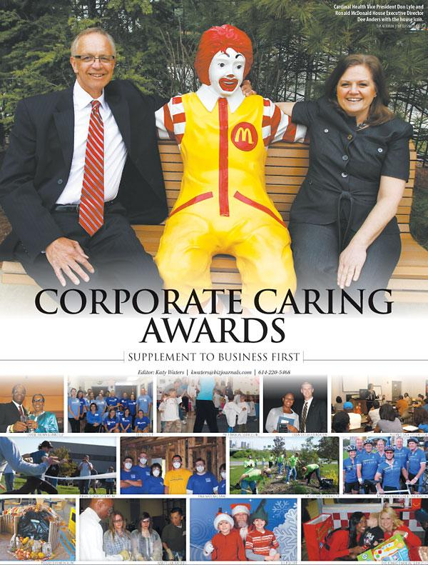 Cardinal Health Vice President Don Lyle and Ronald McDonald House Executive Director Dee Anders with the house icon.