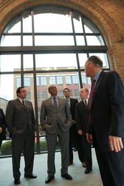 Nationwide Realty President Brian Ellis, right, gave a tour Monday to media and local officials, including Columbus Mayor Michael Coleman, center.