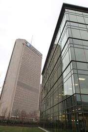 The five-story building sits in the shadow of the insurance company's downtown headquarters.