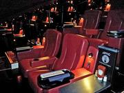 Each seat has a side table, a wide armrest, a drink holder and a call button to summon wait staff.