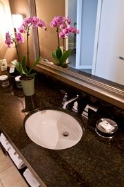 Flowers provide a nice accent in the bathroom.