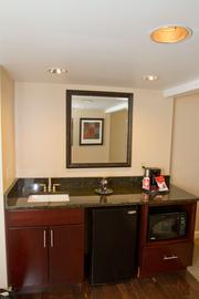 A wet bar with microwave lets guests handle basic meals.