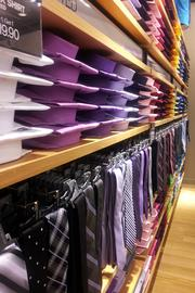 Vibrant colors line the walls in men's shirts and ties.