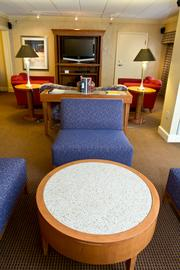 The suite has two separate seating areas.