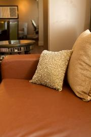 Beaded pillows accent a leather couch.