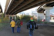 The team heads into a homeless camp behind the convention center with medicine and gear.