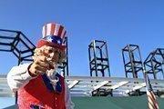 Richard Renner plays Uncle Sam on stilts.