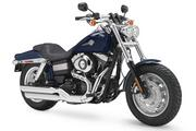 """The oversized Dyna Fat Bob """"tears up the road with big power and unmistakable attitude,"""" according to the company's promotional materials. It retails starting at $15,349."""
