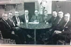 This 1965 photo shows the original Bob Evans corporate board, from left, Herman Martin, C.H. McKenzie, Harland Martin, Bob Evans, Emerson Evans, Dan Evans, Tim Evans, Bob Wood and Morris Haskins.