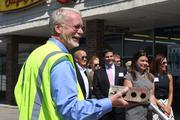 George Hadler receives a brick after tearing down part of the Westerville Square Shopping Center.