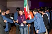 A group of workers from Honda operations in Mexico are greeted by executives at the company's NH-Circle World Bloc Convention in Columbus.