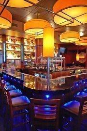 The bar area at an Ocean Prime in Denver.