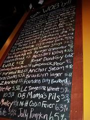A chalk board catalogs the various beers that patrons can find at World of Beer's tavern in Easton.